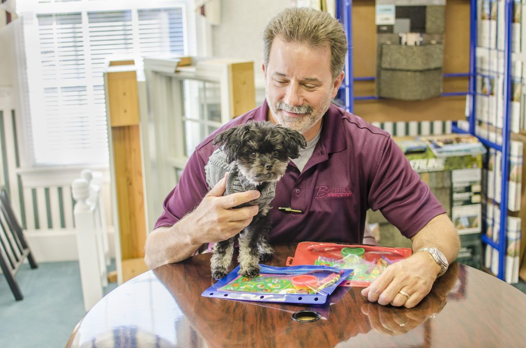 Owner, Chris Balducci, getting some help from our office pup, Zoey