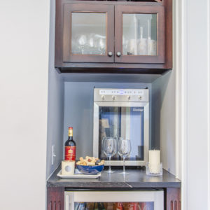 Custom wine bar installed in place of a small closet
