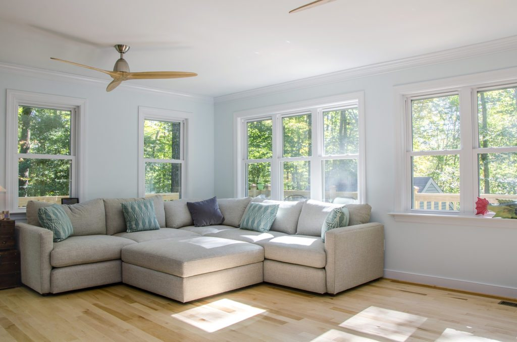 sunroom home addition with triple windows