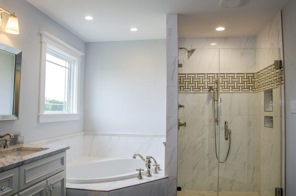classic master bathroom with white granite