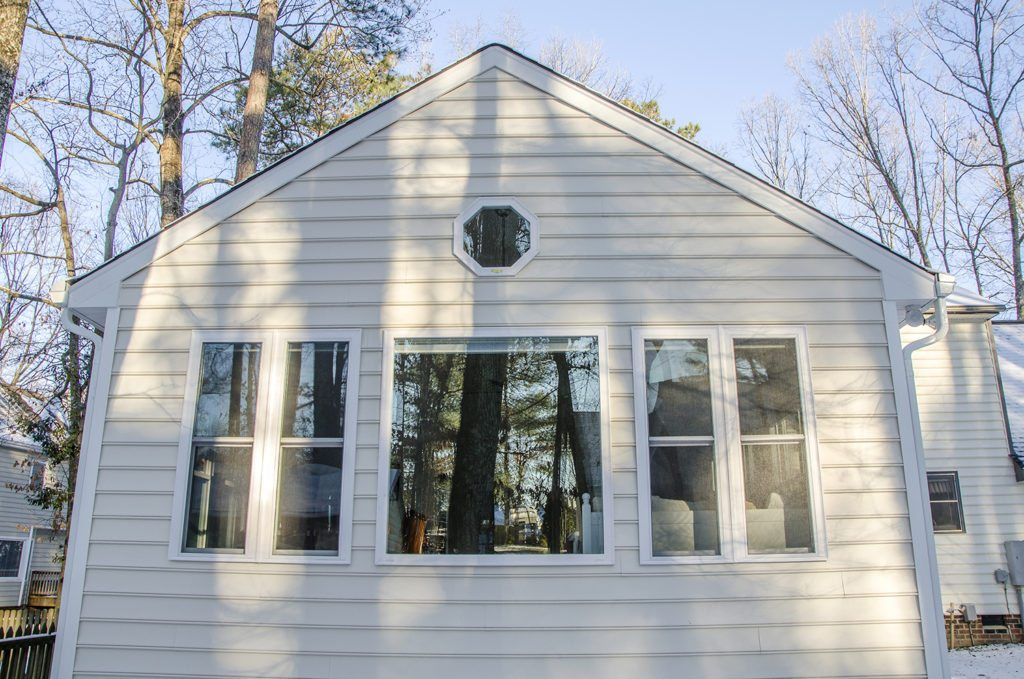 exterior of the sunroom addition with decorative window