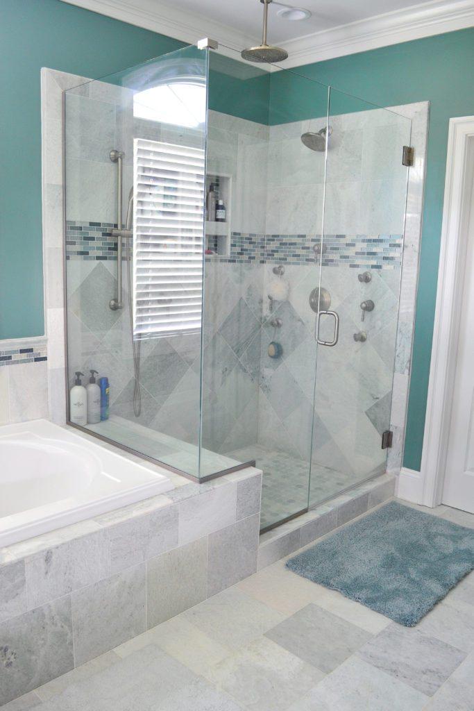 corner shower glass enclosure and a pivot shower door