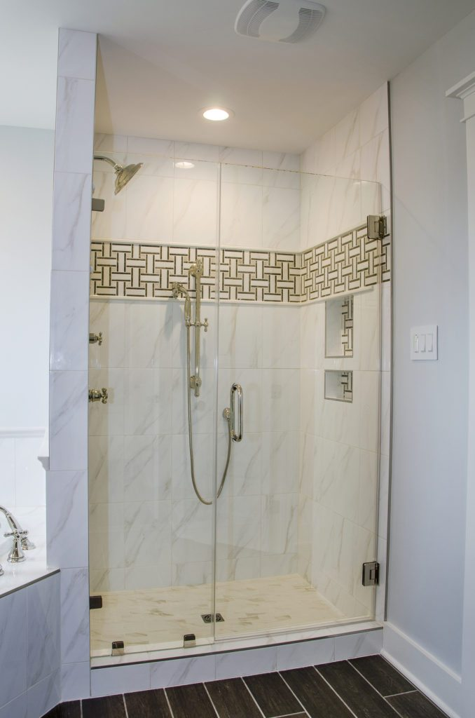 custom bathroom with a clear shower door and stainless hardware