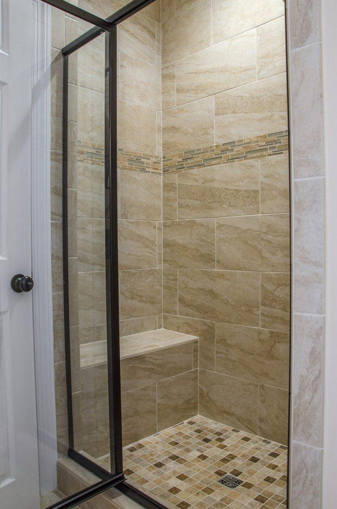 shower door with a dark bronze frame