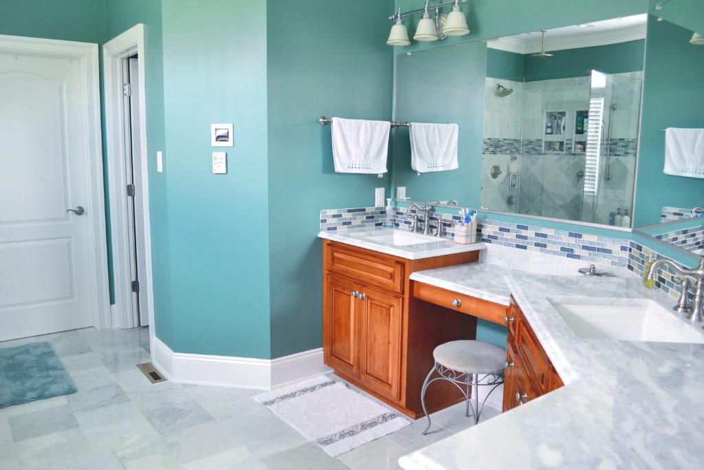 bathroom remodel with turquoise walls