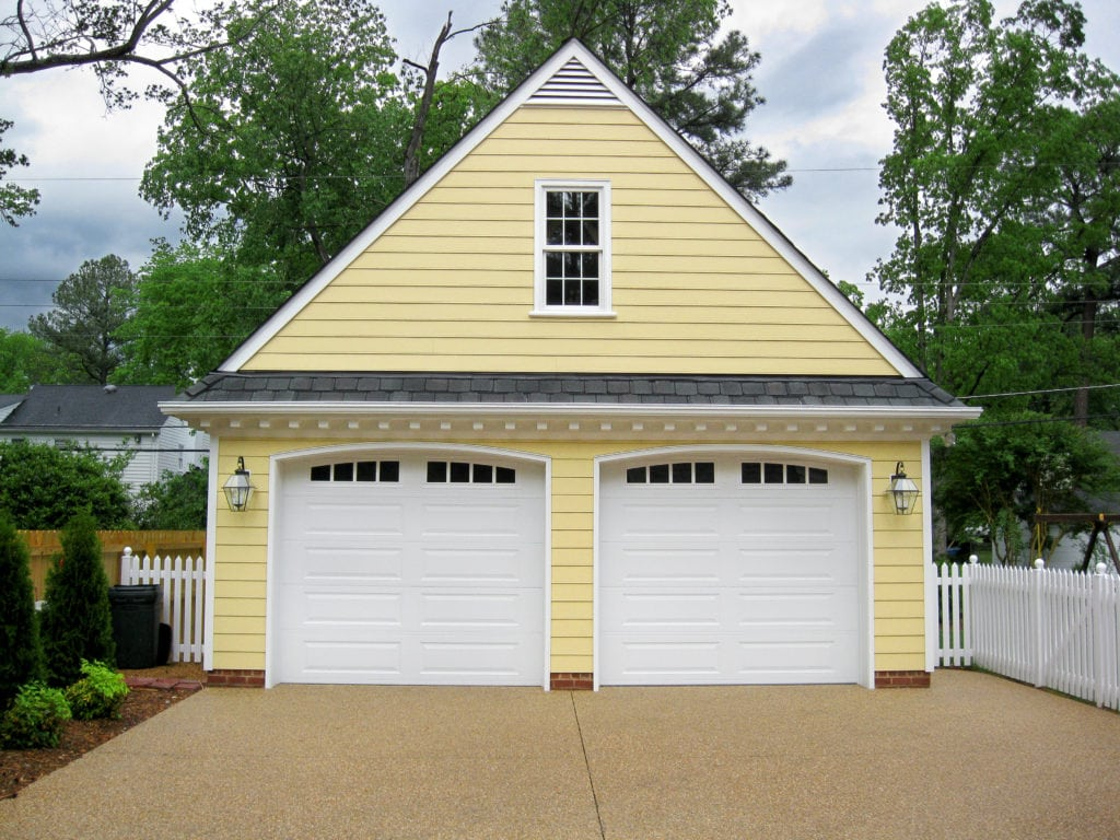 "garage addition with an ""A"" roof and yellow siding"